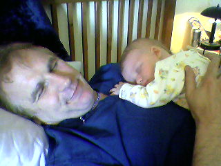 Infant and Dad sleeping